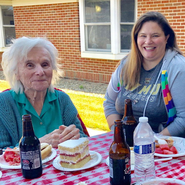 staff having lunch with memory care patient