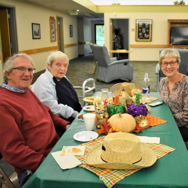 seniors visiting with family at memory care facility in Kalamazoo